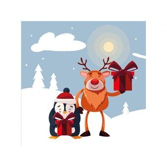 Renne et pingouin avec boîte-cadeau dans un paysage d'hiver
