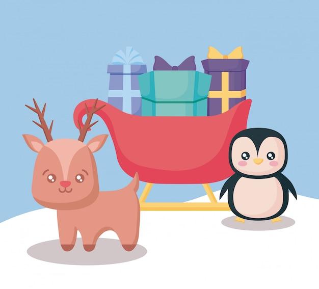 Rennes avec traîneau de boîtes-cadeaux et pingouin de noël