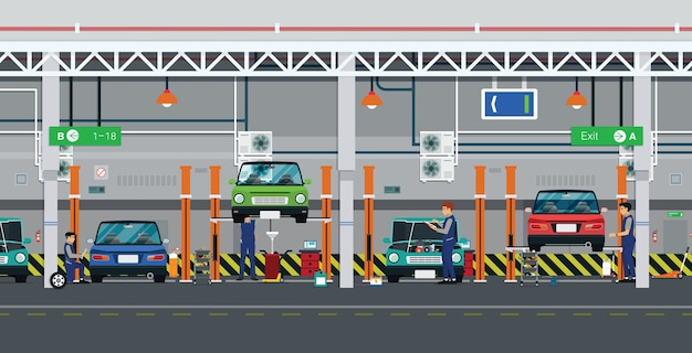 Réparateurs de voitures dans le centre de service