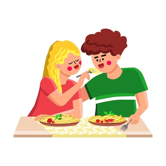 Repas de pâtes manger garçon et fille ensemble vecteur. jeune homme et femme mangent de délicieuses pâtes avec des légumes dans un restaurant italien ou à la maison. personnages spaghetti recette gourmet illustration de dessin animé plat