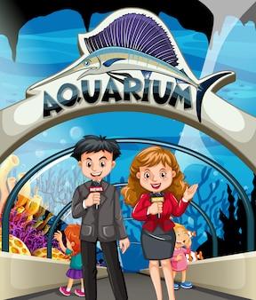 Reporters faisant l'histoire à l'aquarium
