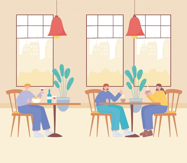 Restaurant distanciation sociale, les femmes et un homme assis à distance dans les tables, prévention des infections à coronavirus