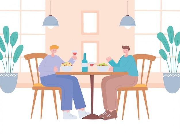 Restaurant distanciation sociale, hommes mangeant dans la table nouvelle vie normale, prévention des infections à coronavirus