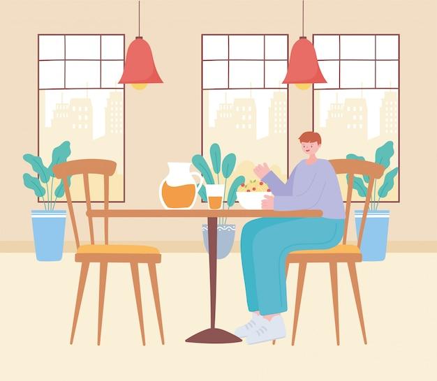 Restaurant distanciation sociale, jeune homme mangeant dans la table, prévention des infections à coronavirus