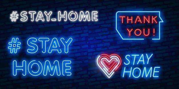 #rester à la maison. enseigne au néon du hashtag «stay home» et du texte «merci»