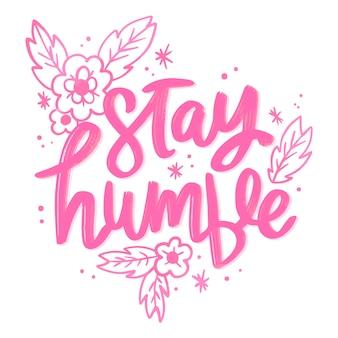 Restez humble lettrage avec des fleurs