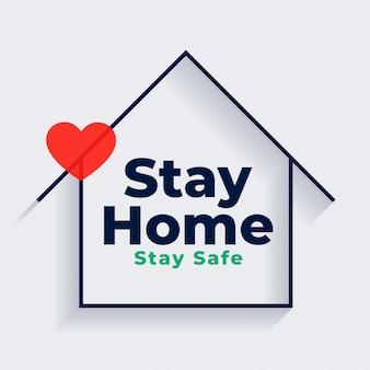 Restez à la maison et en sécurité avec la maison et le symbole du cœur