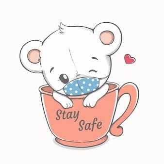 Restez en sécurité message sur une tasse de café avec un rat mignon portant un masque facial dessiné à la main