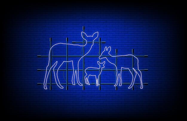 Résumé historique de la famille des cerfs lumineux au néon sur le mur de briques
