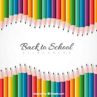 Retour à l'arrière-plan de l'école avec des crayons colorés