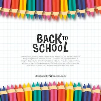 Retour à l'arrière-plan de l'école avec des crayons de couleur