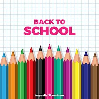Retour à l'arrière-plan de l'école avec des crayons réalistes
