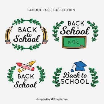 Retour à la collection d'étiquettes d'école avec des éléments