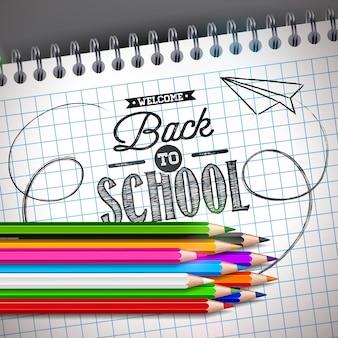 Retour à la conception de l'école avec un crayon coloré et un cahier
