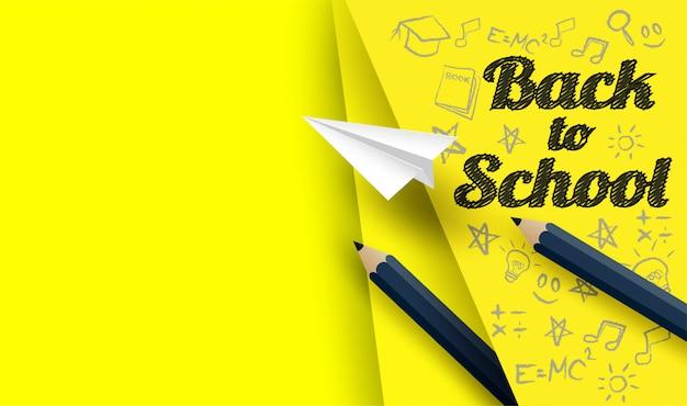 Retour à la conception de l'école avec des crayons et dessin sur fond de papier jaune