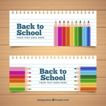 Retour à l'école des bannières dans le style de note avec des crayons