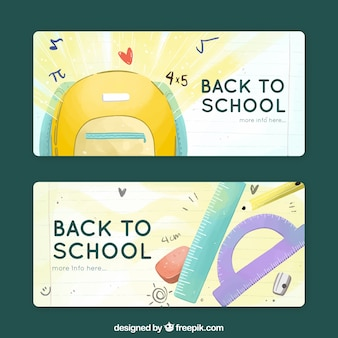 Retour à l'école des bannières en style dessiné à la main