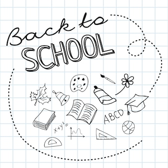 Retour à l'école lettrage sur papier quadrillé et gribouillis dessinés à la main