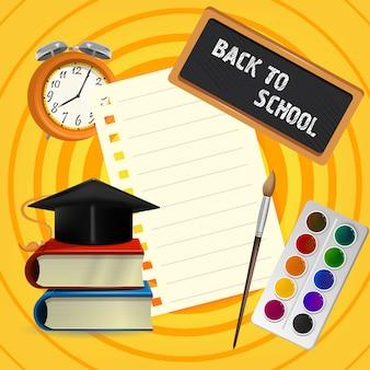 Retour à l'école lettrage sur tableau noir avec chapeau de graduation