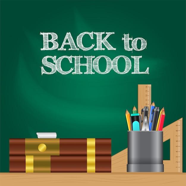 Retour à l'école avec un livre et un étui à crayons sur la table