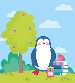 Retour à l'école, pingouin pomme sur livres couleur crayon en plein air