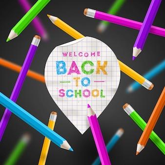 Retour à l'illustration de l'école - pointeur de carte papier avec voeux dessinés à la main et crayons de couleur