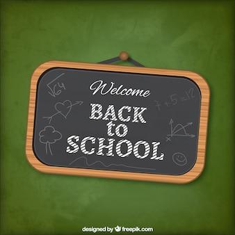 Retour à lettrage sur le tableau noir de l'école