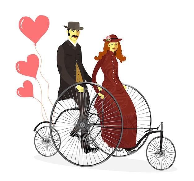 Retro loving couple homme et femme sur des bicyclettes avec des ballons