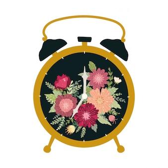 Réveil rétro noir isolé sur fond blanc. belle horloge de table vintage avec des fleurs.