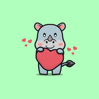 Rhinocéros mignon tenant illustration d'icône amour dessin animé