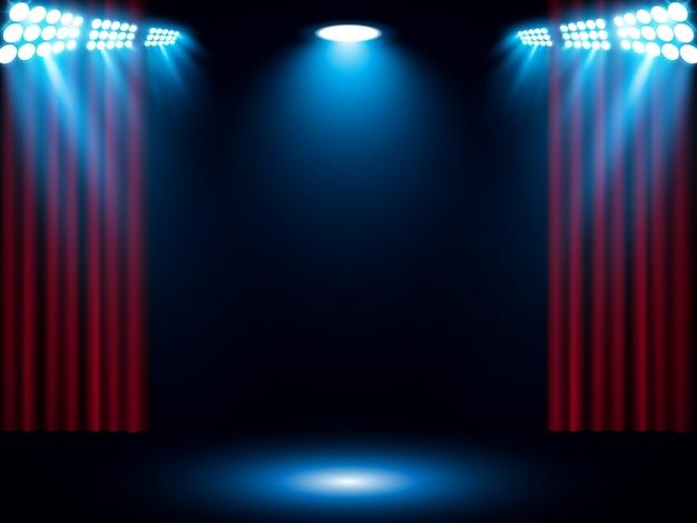 Rideau de scène rouge avec projecteur bleu