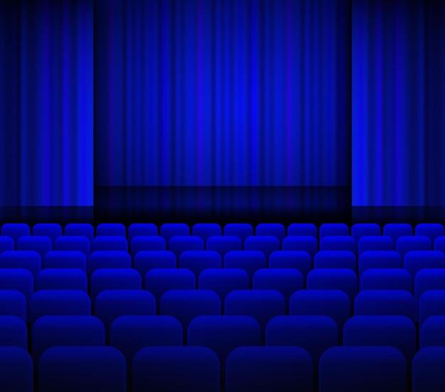 Rideaux bleus de théâtre ouverts avec lumière et sièges.