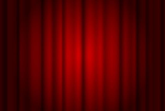 Rideaux rouges large fond éclairé par un faisceau de projecteur. rideau de spectacle de théâtre rouge