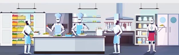 Robots modernes chefs cuisiner des plats cuisiniers robotiques préparer des aliments