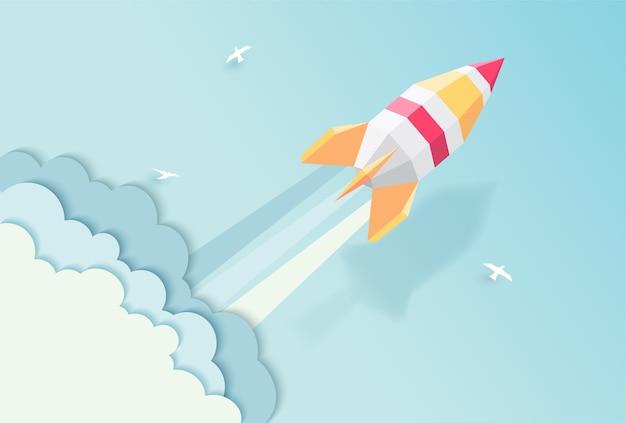 Rocket sur le style d'art papier fond bleu