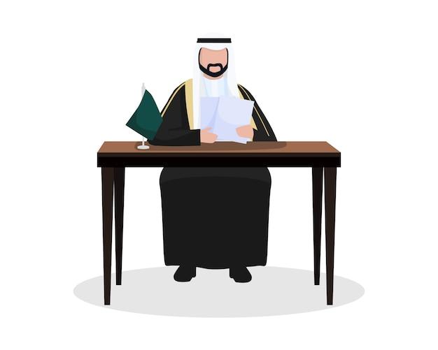 Le roi d'arabie saoudite lit et attribue un contrat sur sa table de bureau
