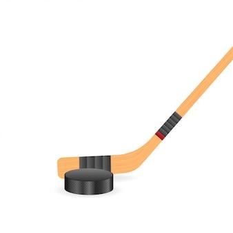 Rondelle et bâtons de hockey sur glace.
