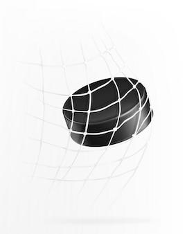 La rondelle de hockey vole dans le but