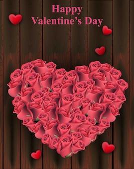 Roses de forme de coeur sur fond de bois, carte de saint valentin