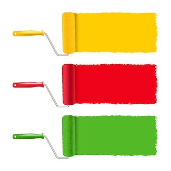 Rouleau de peinture coloré et coup de peinture sur fond blanc