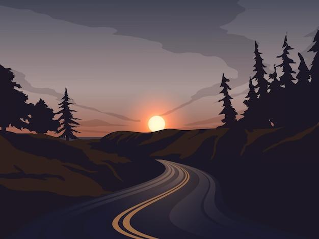 Route vide au coucher du soleil avec forêt