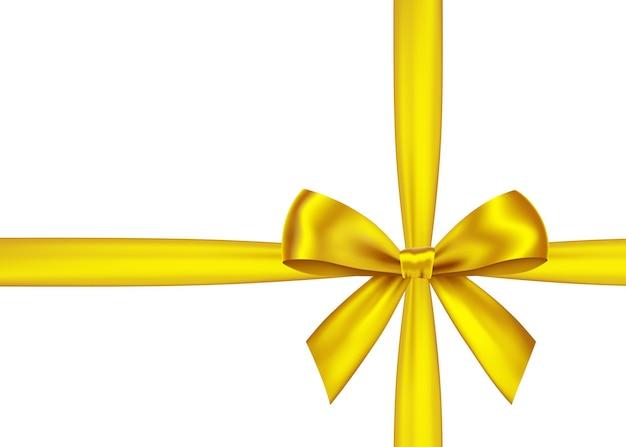 Ruban de cadeau d'or et arc isolé sur blanc