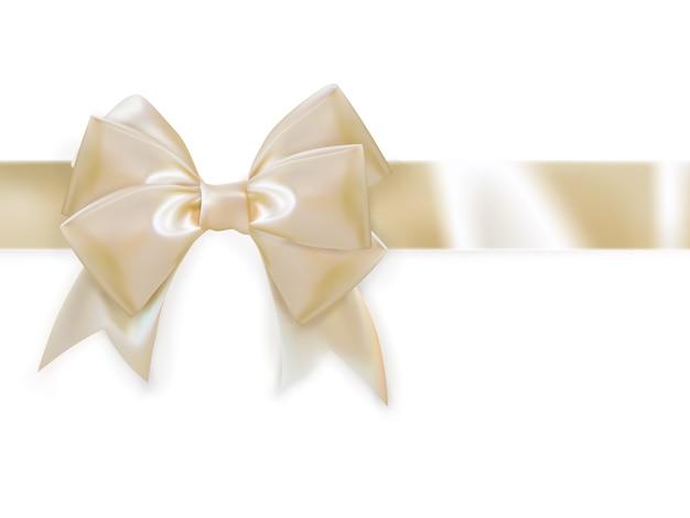 Ruban d'or avec noeud sur blanc.