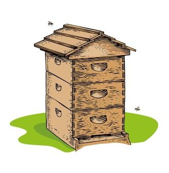 Ruche d'abeilles en bois isolée et deux abeilles