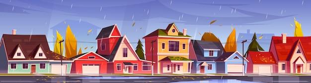 Rue d'automne dans le quartier de banlieue avec maisons