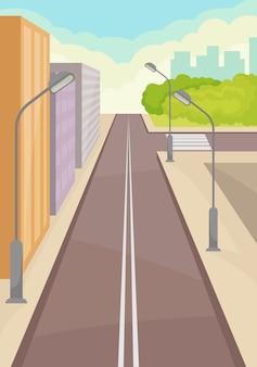 Rue de la ville avec route, immeubles de grande hauteur, lampadaires et passage pour piétons.