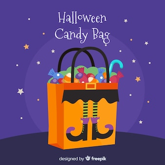 Sac de bonbons colorés d'halloween avec un design plat