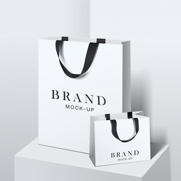 Sac de courses . sacs en papier blanc blanc. shopping package de produits pour le modèle de marque d'entreprise.