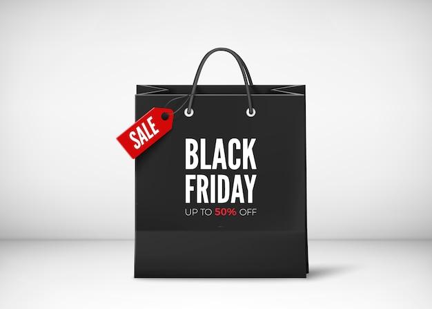 Sac en papier noir avec étiquette vente et texte. modèle de bannière de vendredi noir. isolé sur fond transparent
