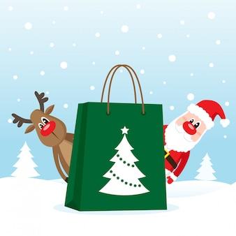 Sac shopping avec le père noël et le cerf sur la neige